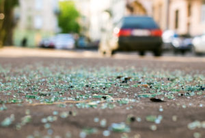 Shards of car glass on the street after car accident
