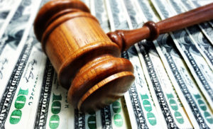 gavel and money: personal injury settlement