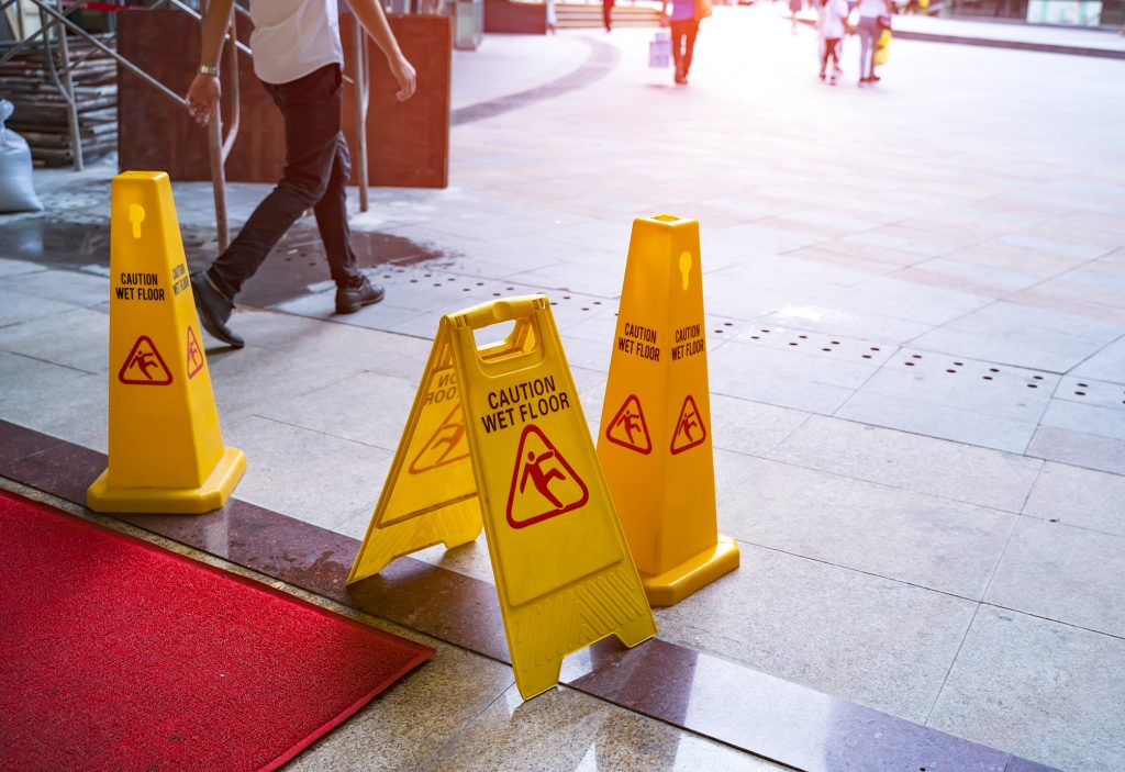 Wet floor sign at a building entrance
