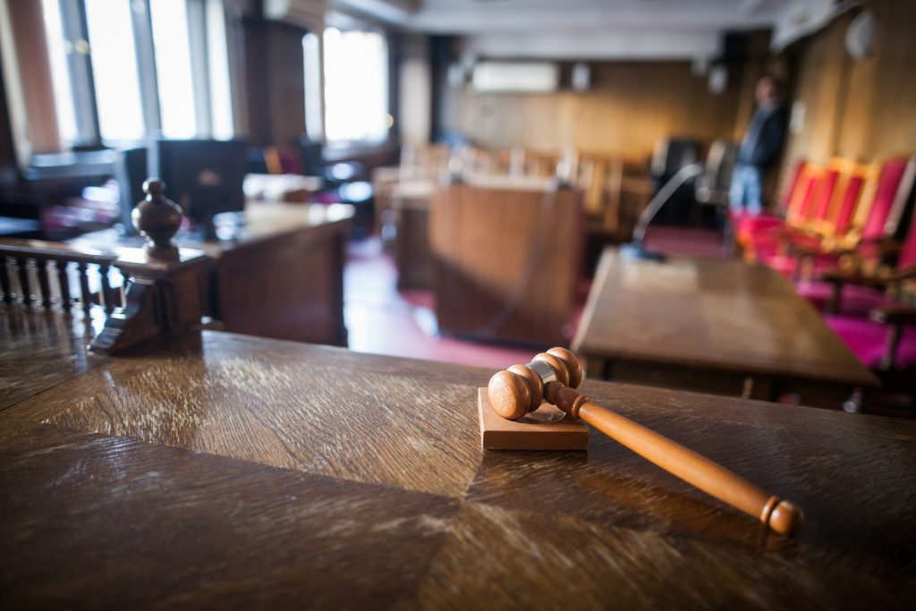 Image of a courtroom and gavel